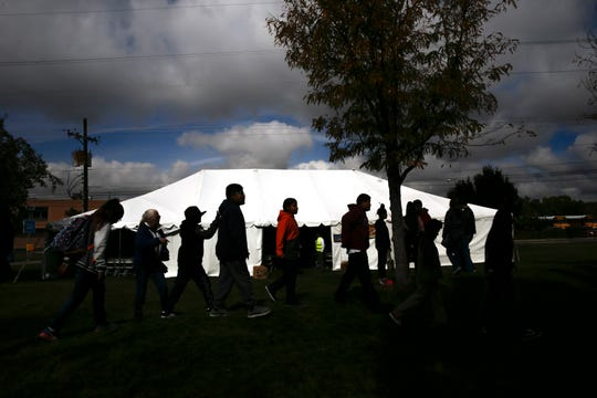Local schoolchildren head to the next tent for more stories Frida during the Four Corners Storytelling Festival at Berg Park in Farmington.