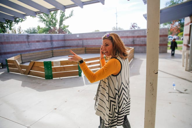 Nikki Taylor, director of development for the Boys & Girls Clubs of Farmington, points out the future location of the John Oliphant Taco Bell Teen Center Friday at the club headquarters in Farmington.