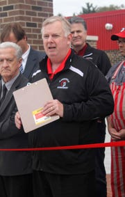 Superintendent Paul Shepich speaks before the ribbon cutting of the new Clarenceville High School athletic complex last fall.