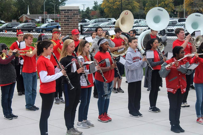 The Clarenceville marching band performs at the dedication ceremony for the new athletic complex.