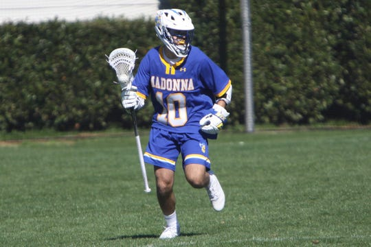 Brendan Daschke, shown playing last season at Madonna University, raved about his experience playing at an international box lacrosse tournament in New York state.