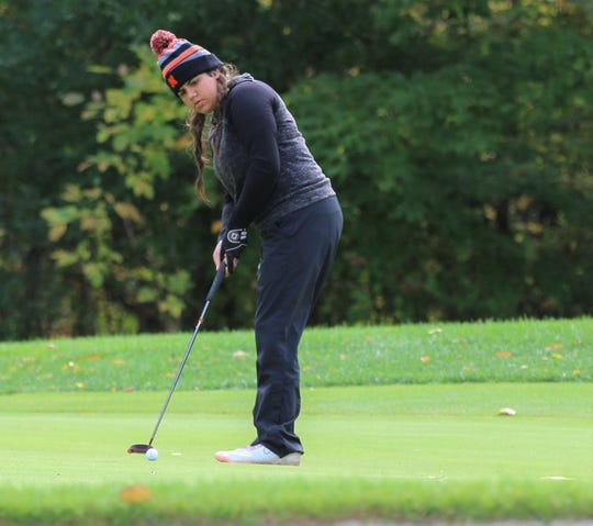 Northville's Sufna Gill takes aim on the green during the Oct. 11 regional at Travis Pointe.