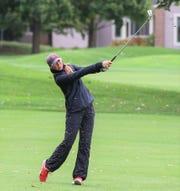 Regional runner-up medalist Mariella Simoncini takes aim on the fairway at Travis Pointe C.C.