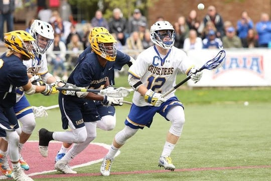According to Ian Rush, shown here playing last season for Madonna University's men's lacrosse team, he wanted to represent his family's Polish heritage and experience a different style of the sport when he signed up for the recent Lax All-Stars North American Invitational.
