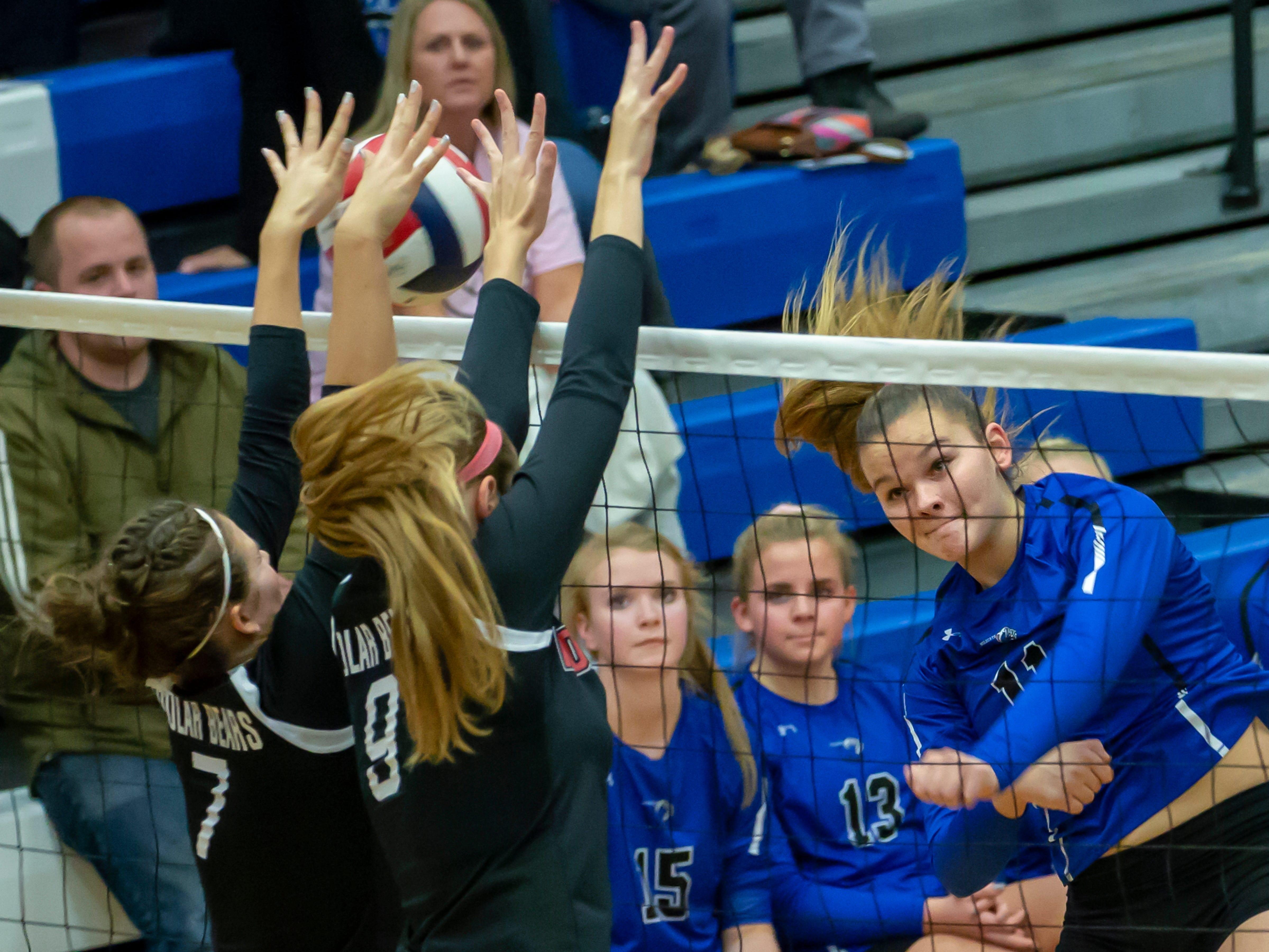 Oshkosh West's Morgan Yenter attempts a shot past Hortonville blockers Haily Meyer and Adrianne Hagen playing at Oshkosh West High School on Thursday, October 11, 2018.