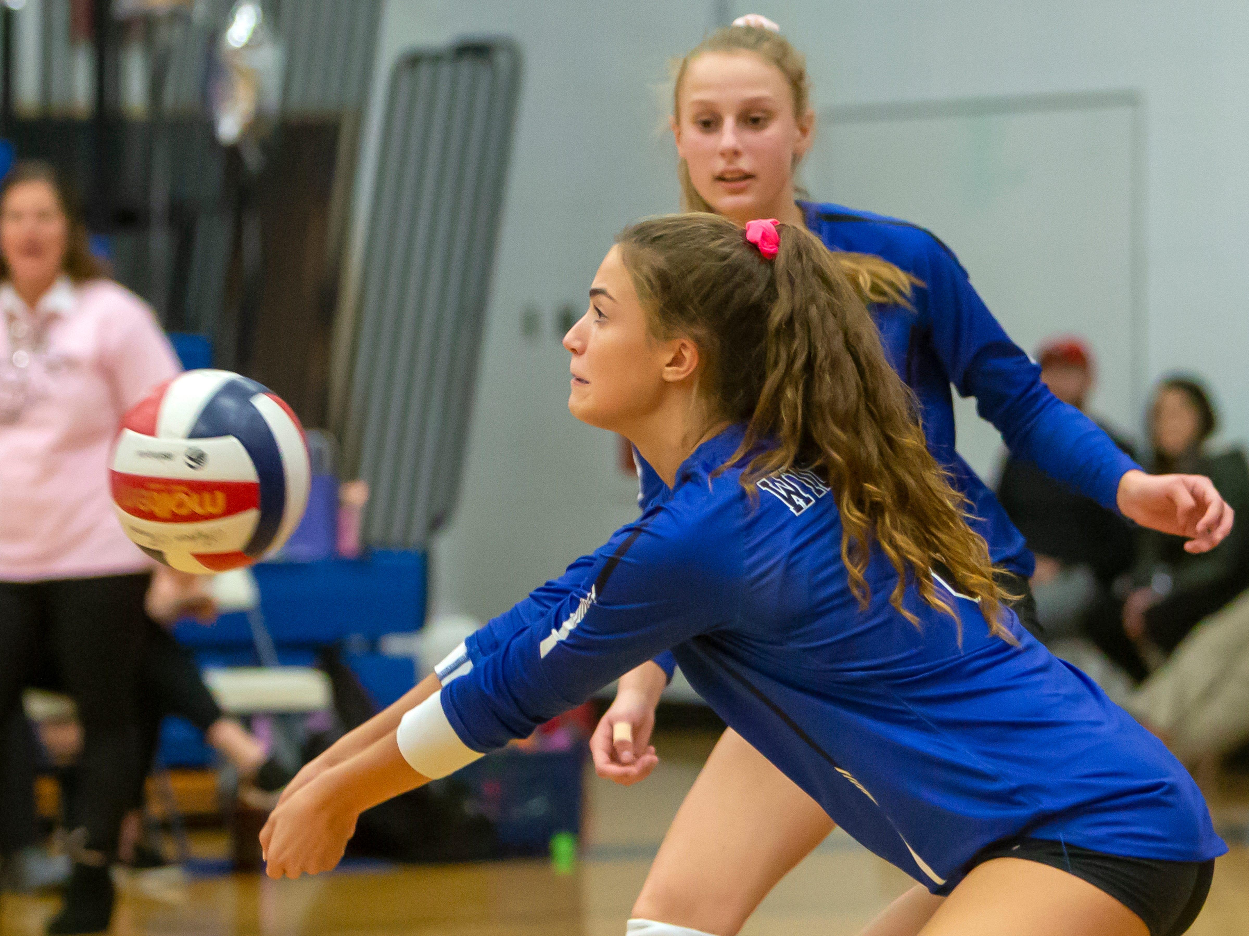 Oshkosh West's Rachel Mueller bumps the ball playing at Oshkosh West High School on Thursday, October 11, 2018.