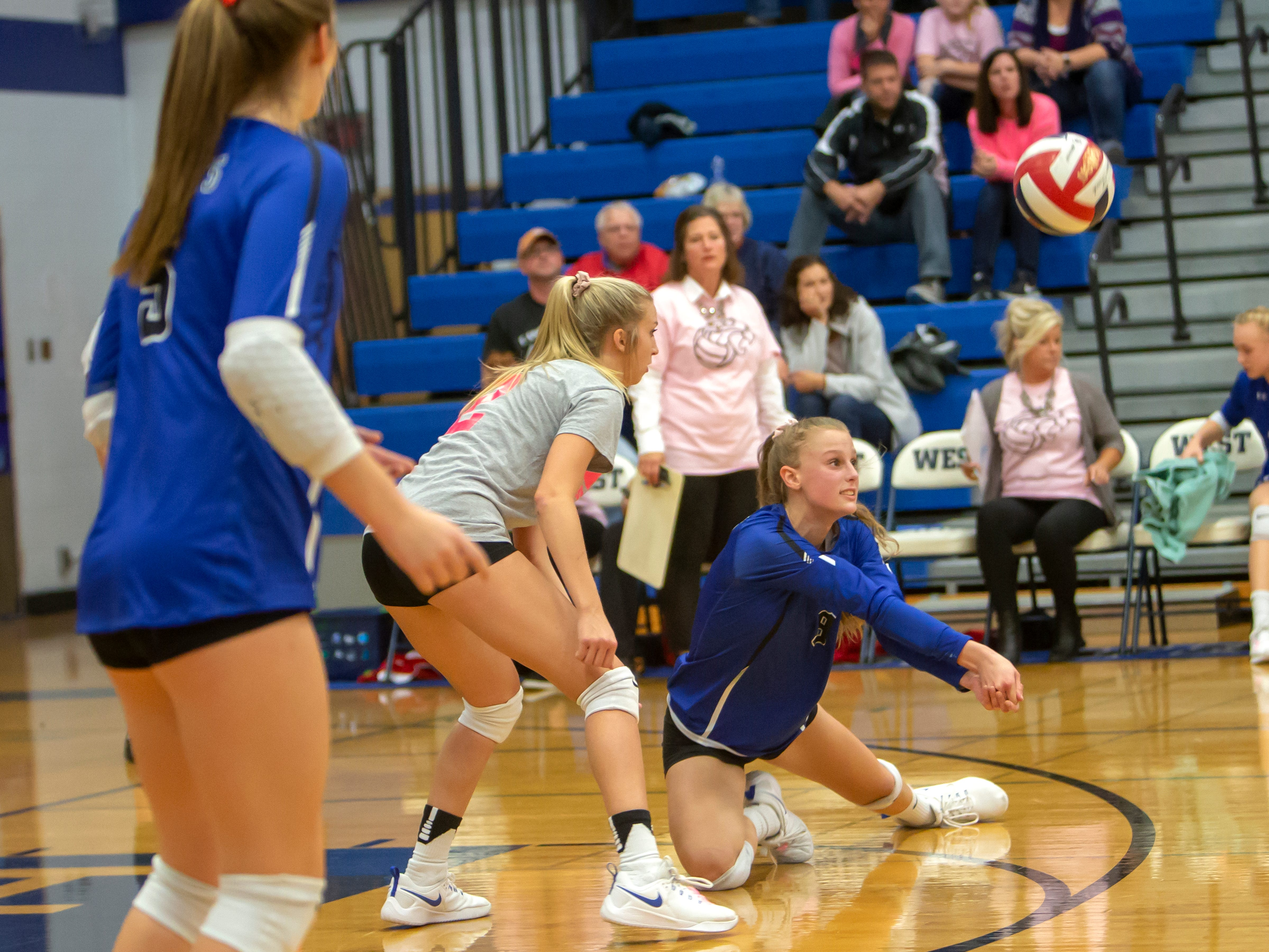Oshkosh West's Eva Beeth dives for the ball playing at Oshkosh West High School on Thursday, October 11, 2018.
