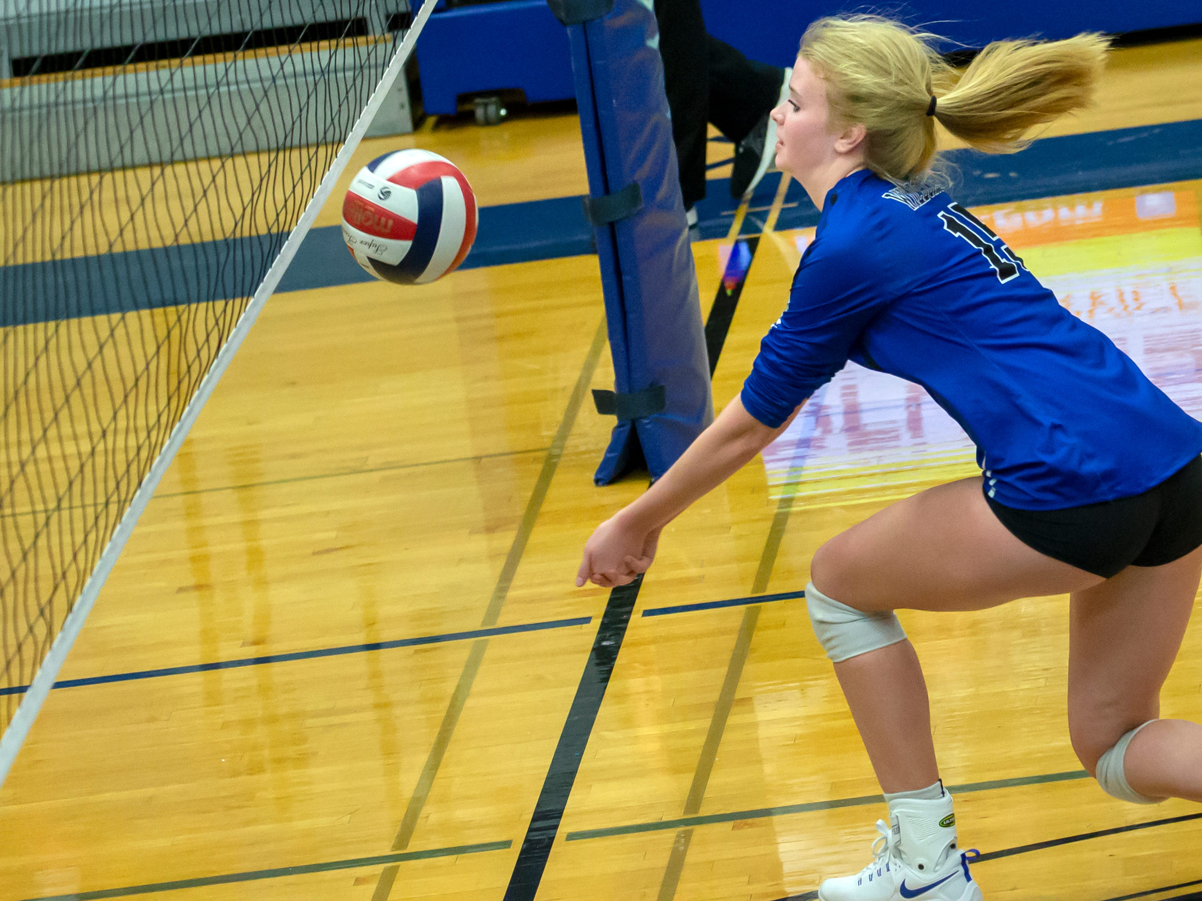Oshkosh West's Randi Wellhoefer attempts to save the ball off the net playing at Oshkosh West High School on Thursday, October 11, 2018.