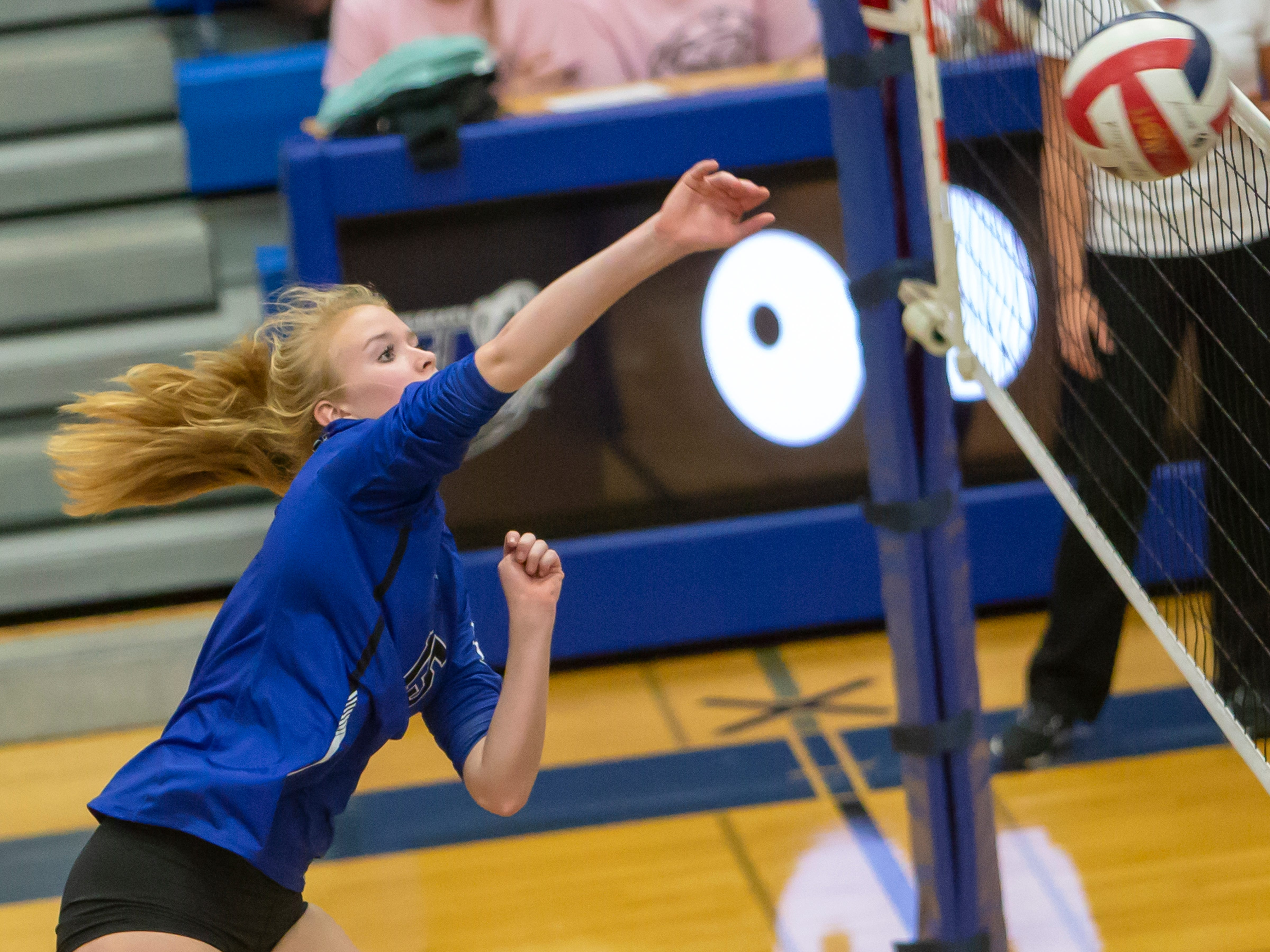 Oshkosh West's Randi Wellhoefer hits a return to Hortonville playing at Oshkosh West High School on Thursday, October 11, 2018.