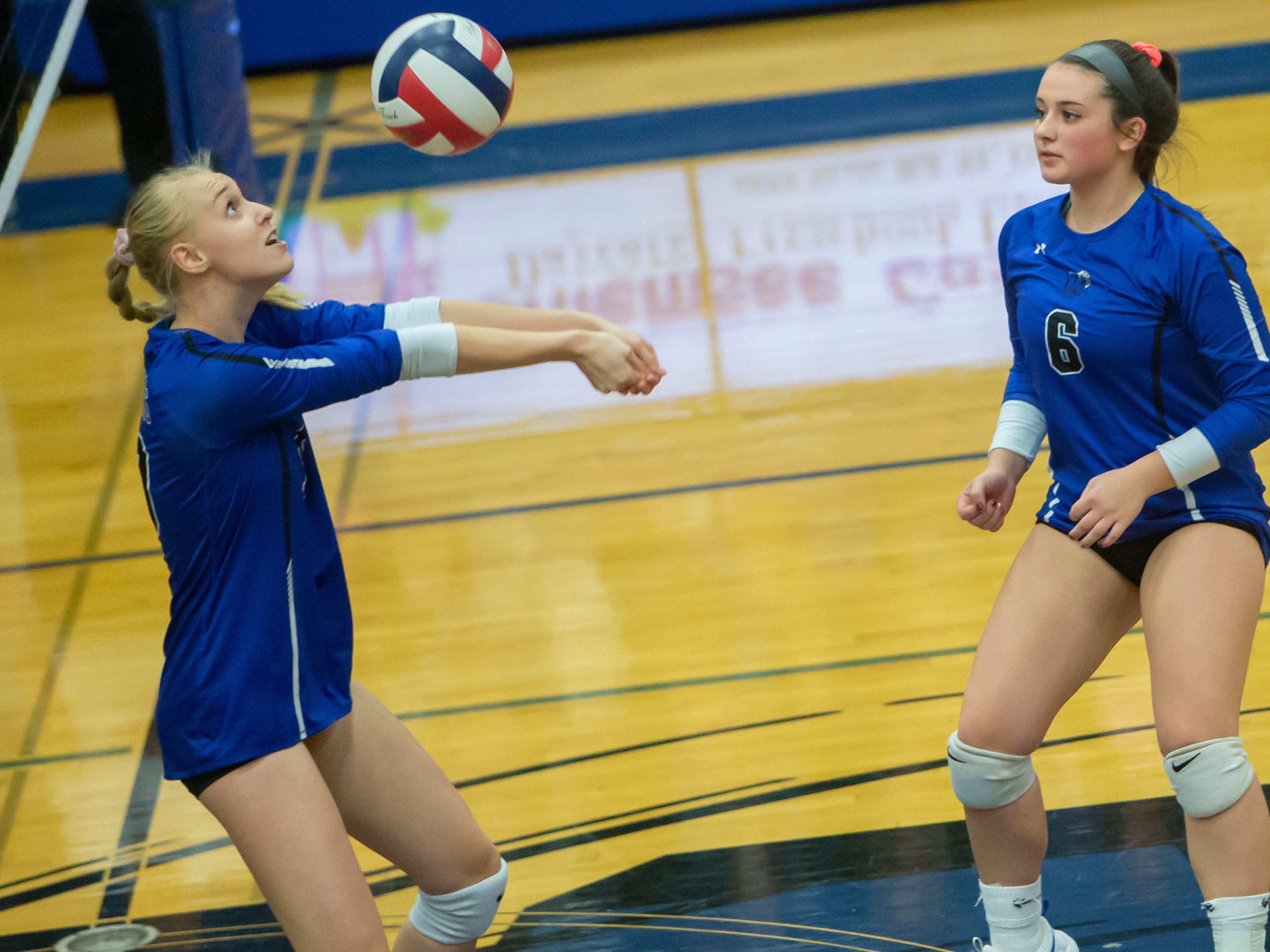 Oshkosh West's Natalie Johnknecht sets up a net shot playing at Oshkosh West High School on Thursday, October 11, 2018.