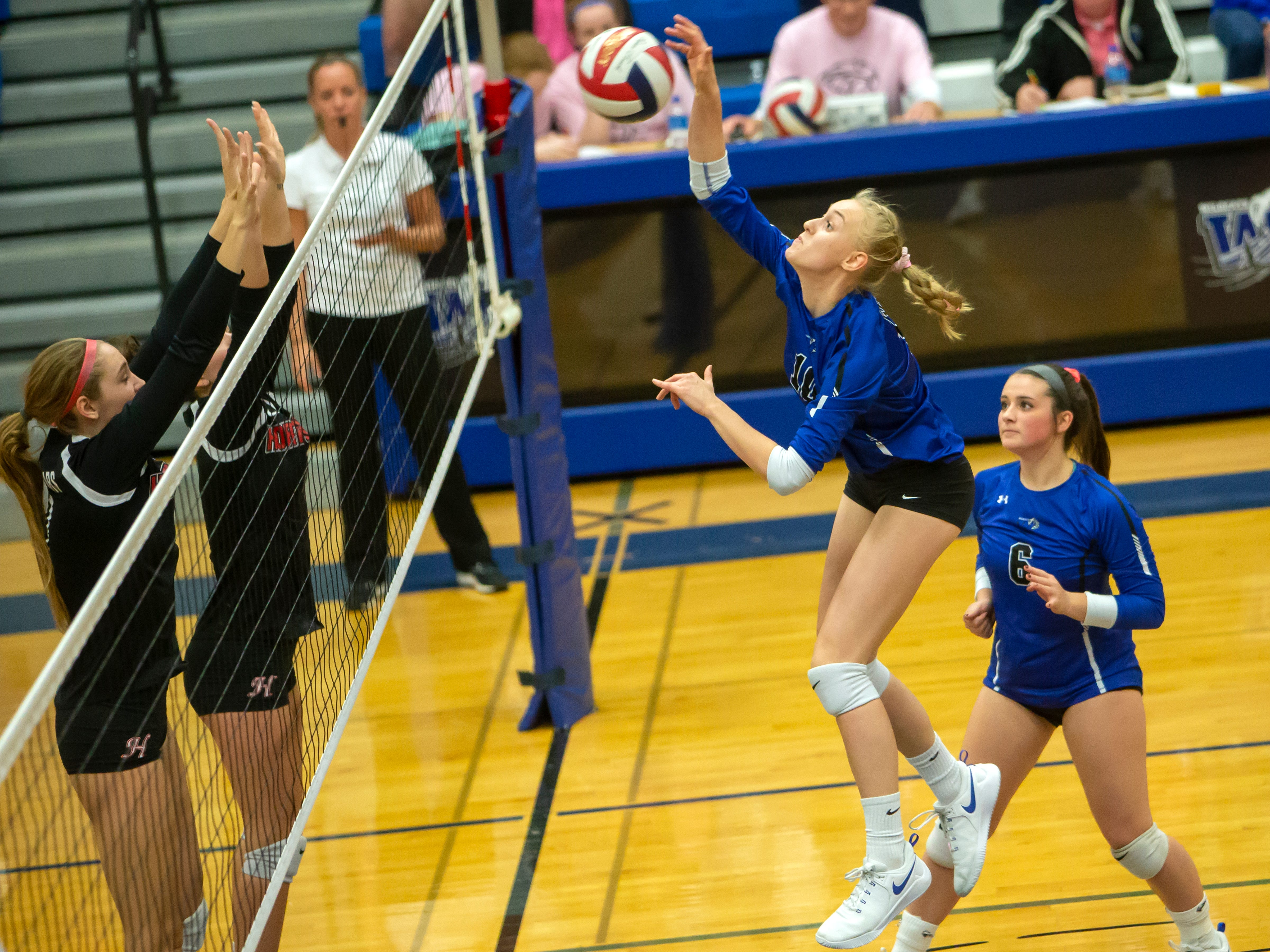 Oshkosh West's natalie Johanknecht takes a shot over to Hortonville playing at Oshkosh West High School on Thursday, October 11, 2018.