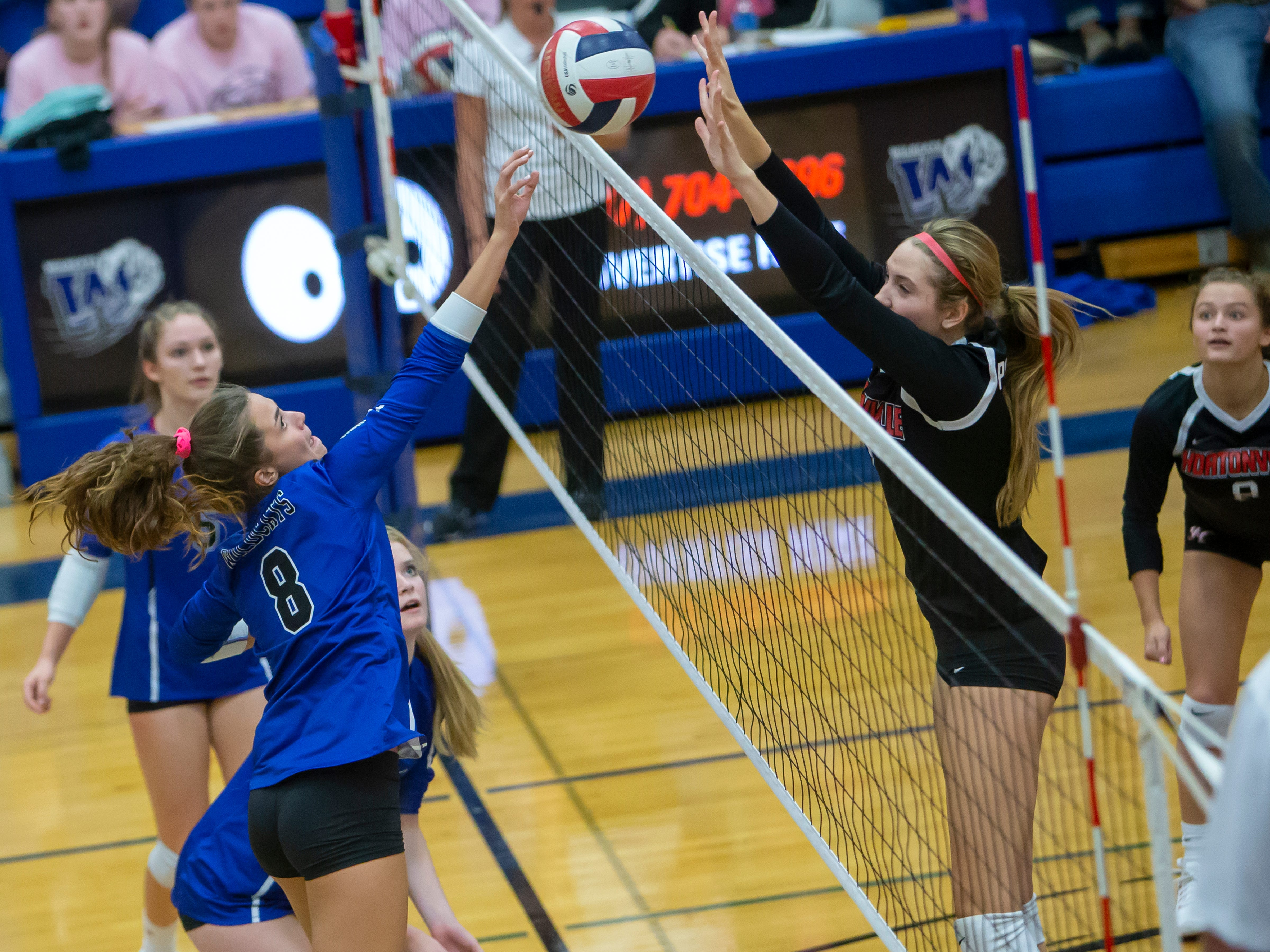 Oshkosh West's Katie Miller volleys the ball over to Hortonville's Adrianne Hagen playing at Oshkosh West High School on Thursday, October 11, 2018.