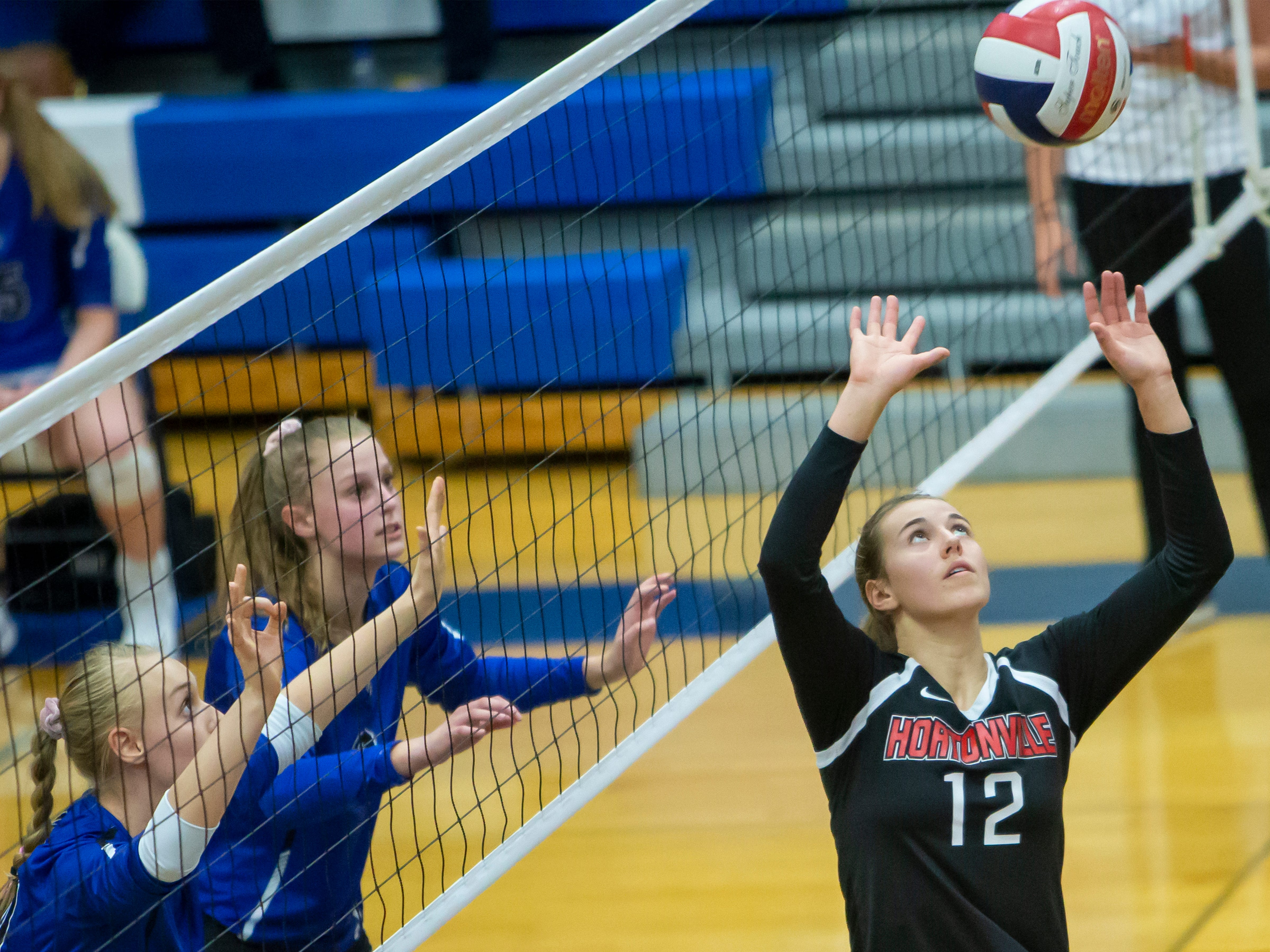 Hortonville's Aliza VanDenElzen sets the ball at the net playing at Oshkosh West High School on Thursday, October 11, 2018.