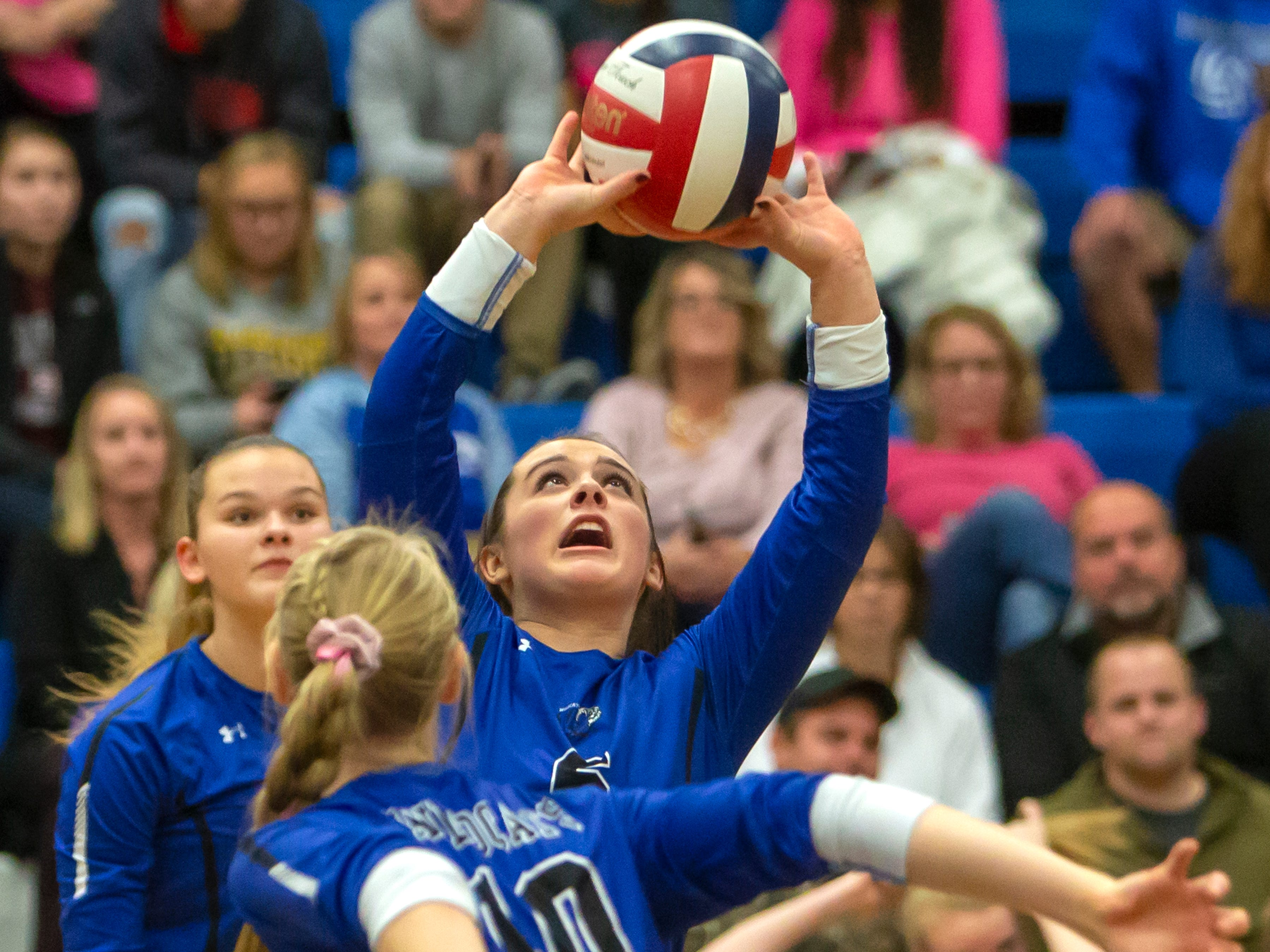Oshkosh West's Madigan Carlson sets the ball for Natalie Johanknecht playing at Oshkosh West High School on Thursday, October 11, 2018.