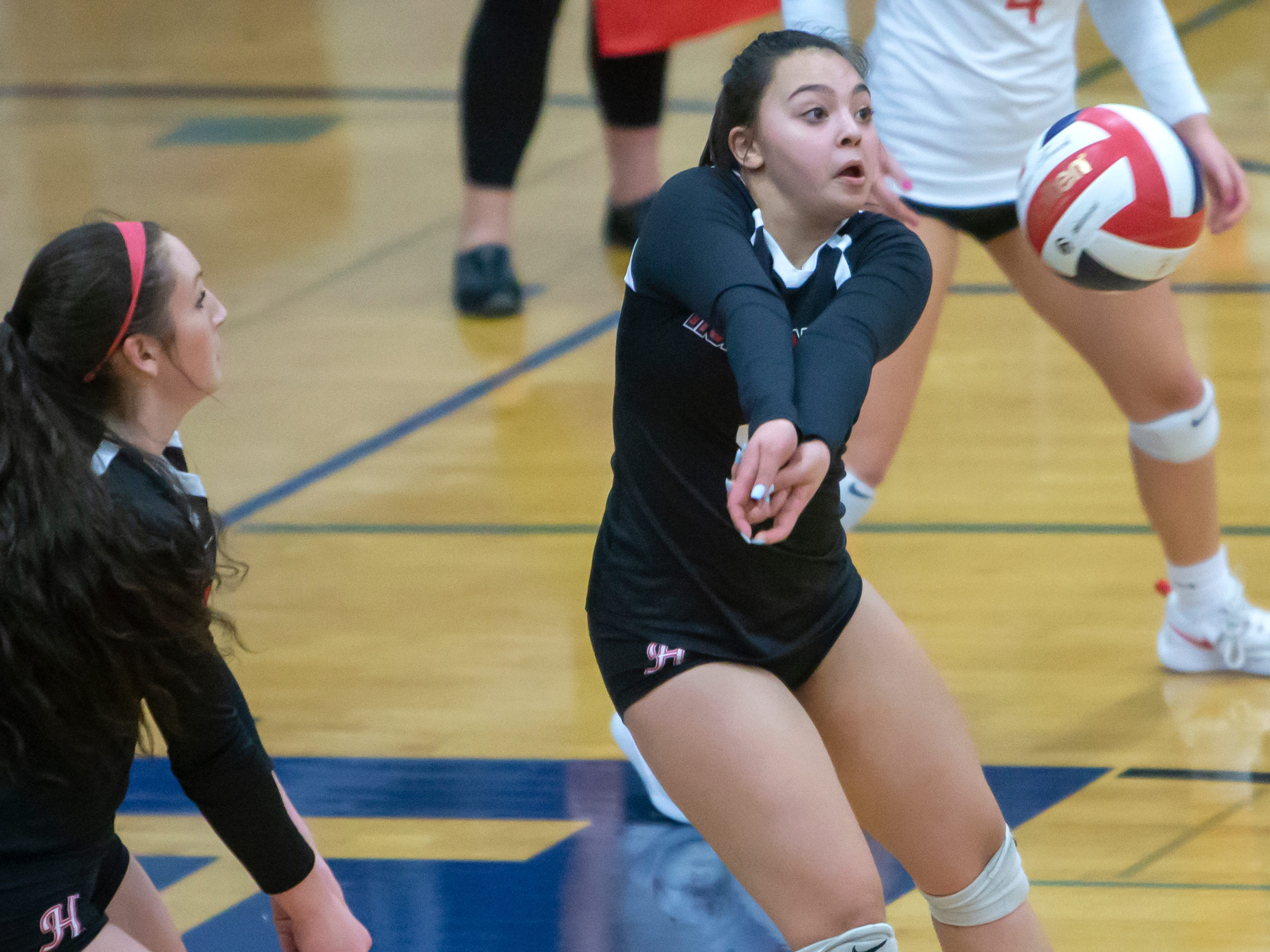 Hortonville's Abby Vela sets up the ball from a Wildcat serve playing at Oshkosh West High School on Thursday, October 11, 2018.