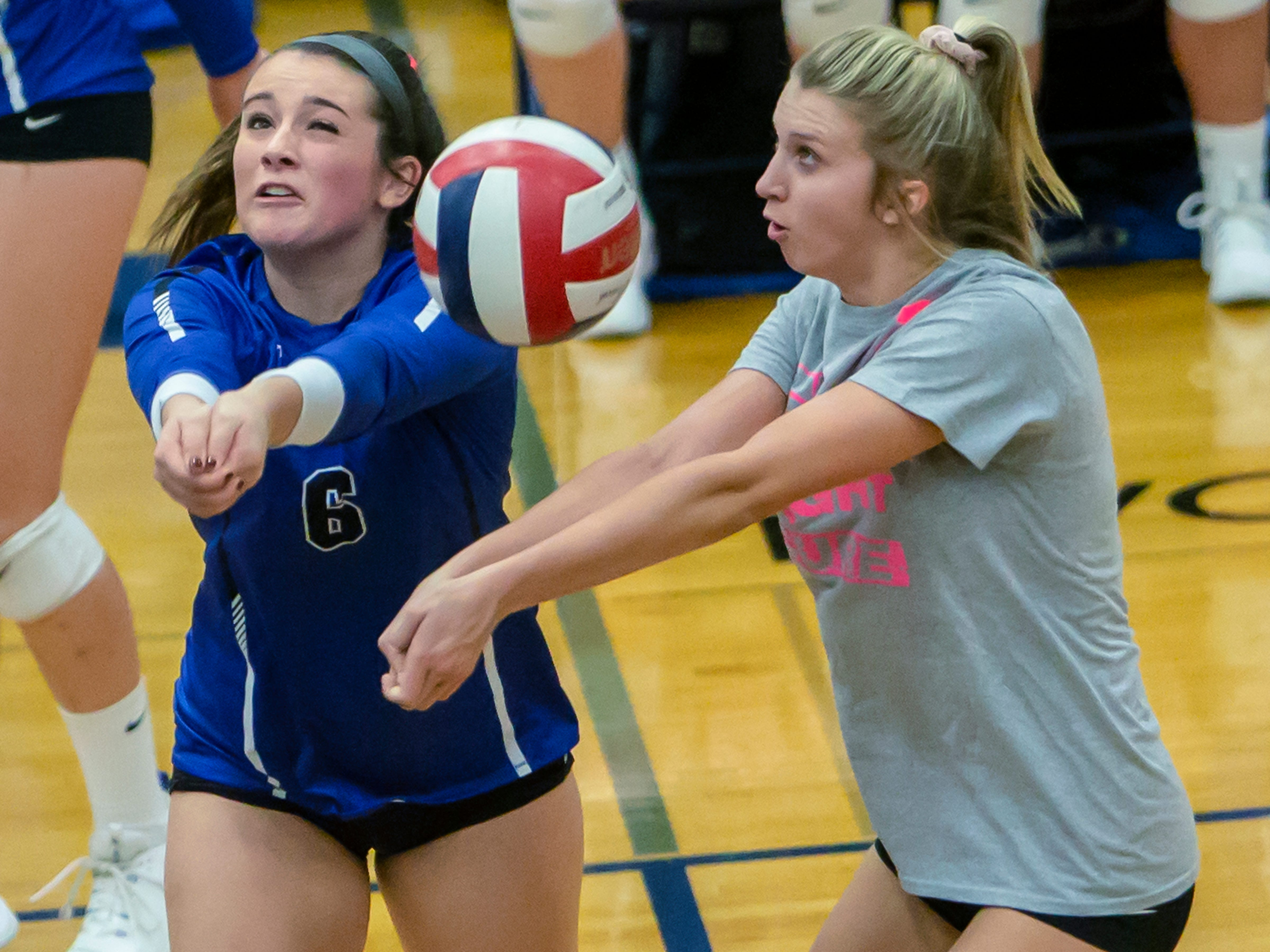 Oshkosh West's Callista Rochon-Baker bumps up the ball with  Madigan Carlson as backup playing at Oshkosh West High School on Thursday, October 11, 2018.