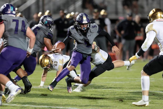 Shadow Hills' Jacob Luna carries the ball for a first down against Xavier Prep on Thursday, October 11, 2018 in Indio.