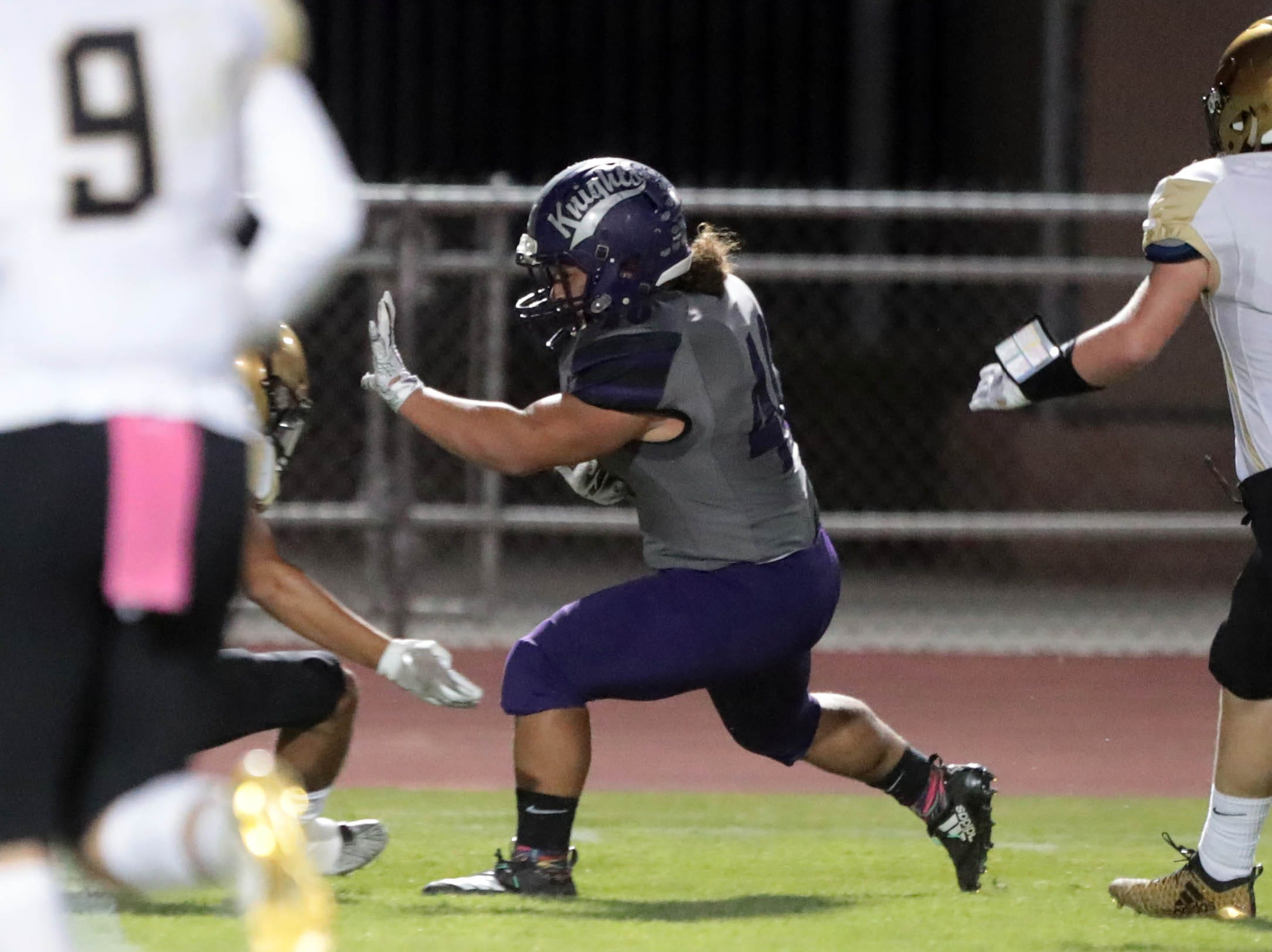 Shadow Hills' Chris Morgan carries the ball for a first down against Xavier Prep on Thursday, October 11, 2018 in Indio.