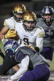 Xavier Prep's Fabrice Voyne carries the ball for a first down against Shadow Hills on Thursday, October 11, 2018 in Indio.