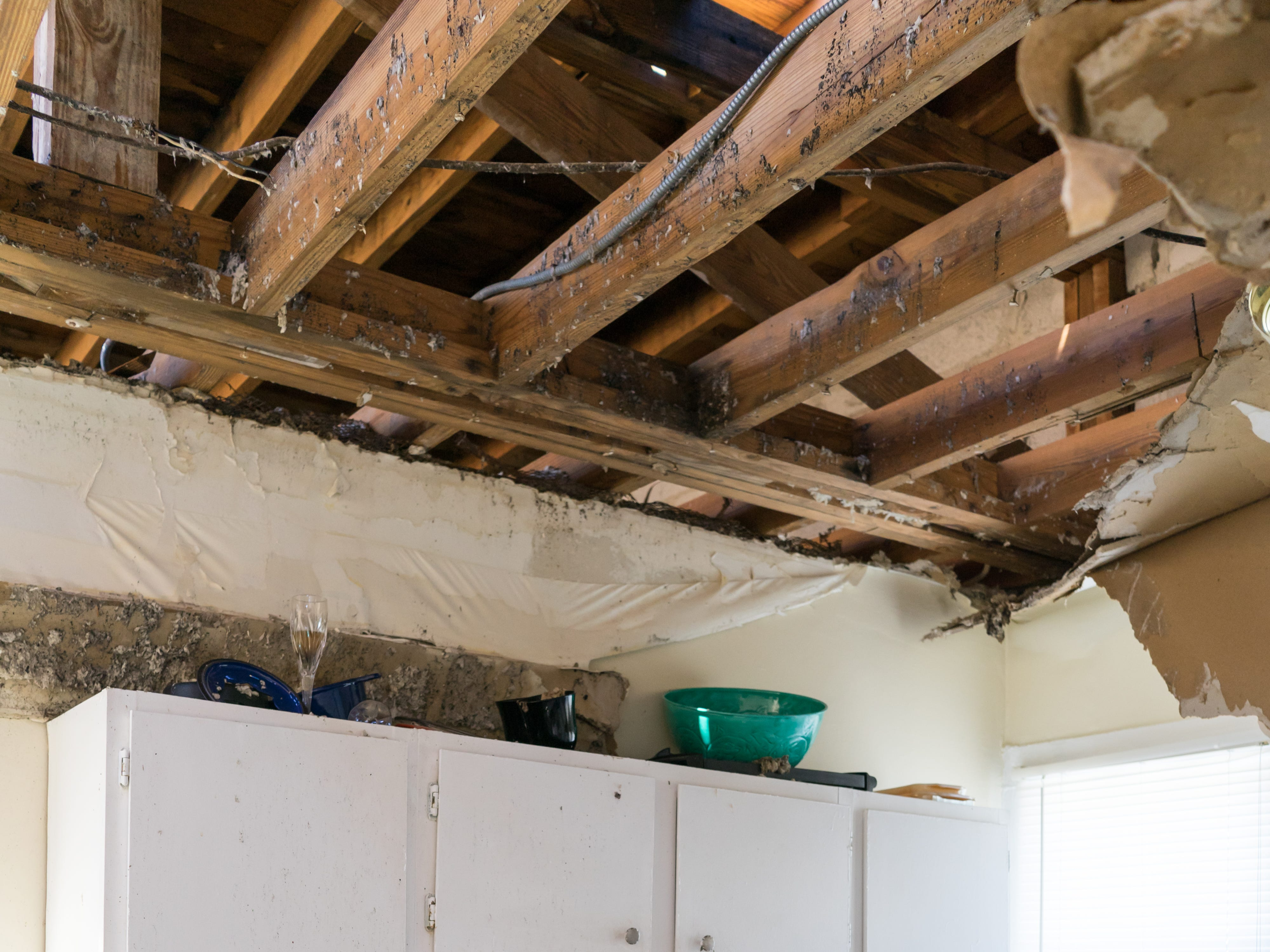 The roof of Jordan Slaughter's apartment was ripped apart, leaving the apartment vulnerable to severe water damage during Hurricane Michael.
