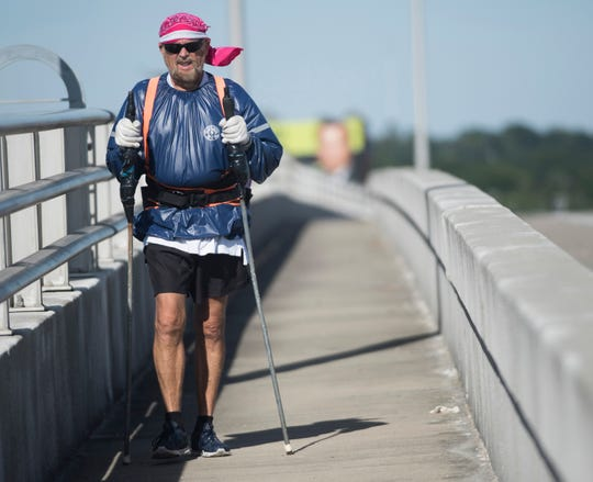 Dana Revette, 72, walks across the Bayou Chico Bridge as a form of exercise on Friday, Oct. 12, 2018