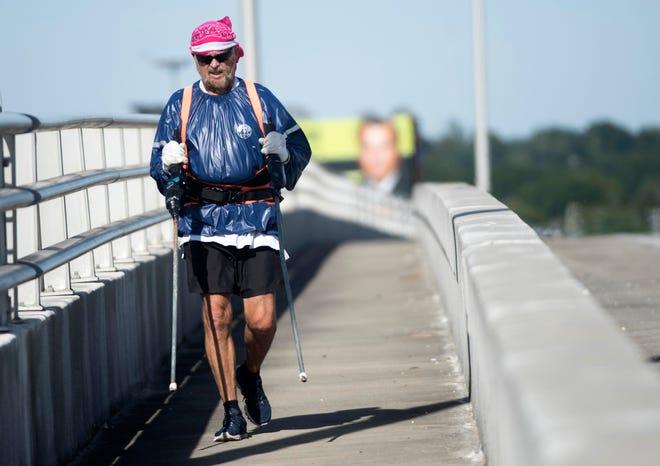 Dana Revette, 71, walks across the Bayou Chico Bridge on Friday.