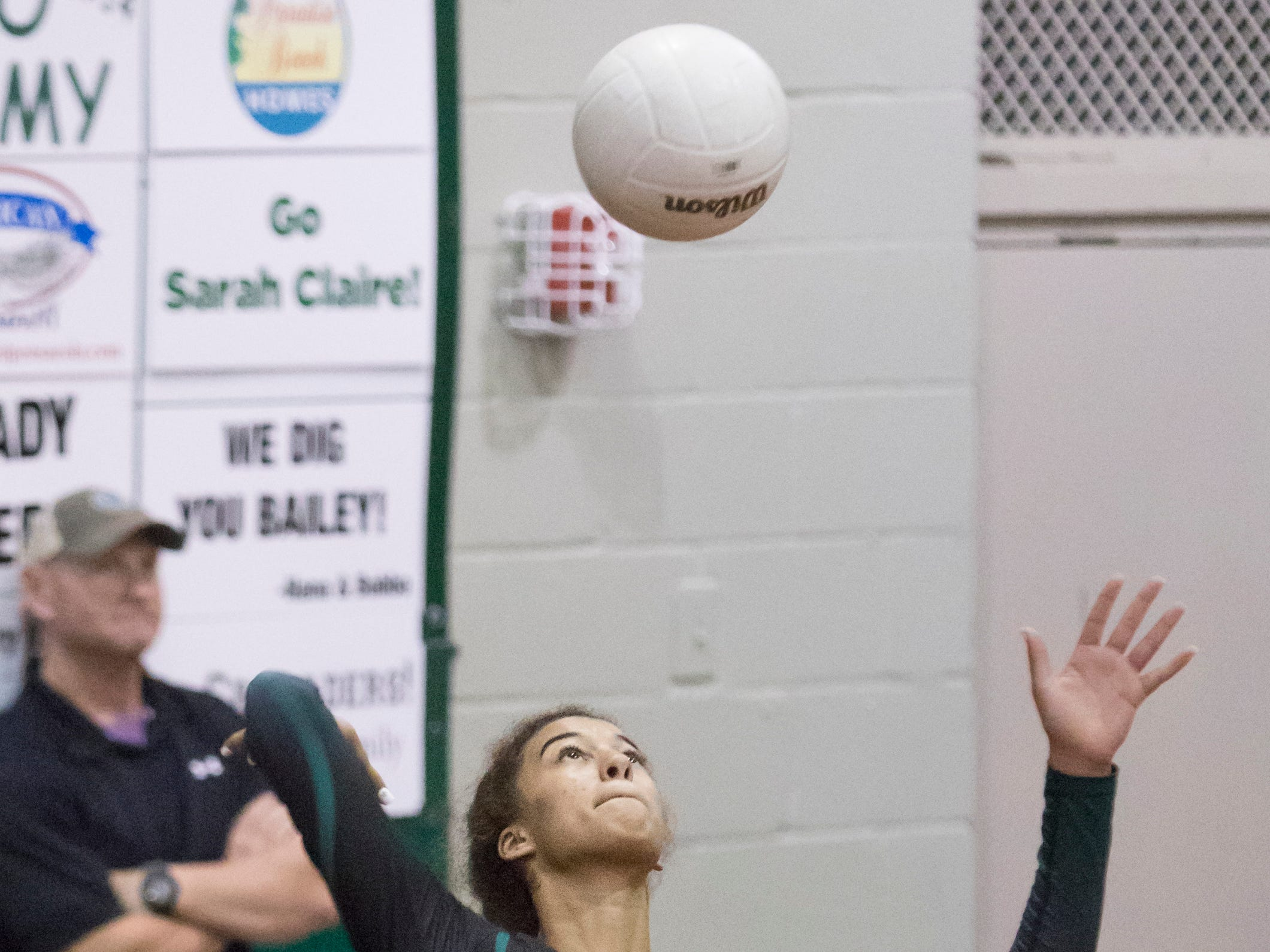 Crusader freshman Amiah Butler (11) serves during the Gulf Breeze vs Catholic volleyball match at Pensacola Catholic High School on Thursday, October 11, 2018.