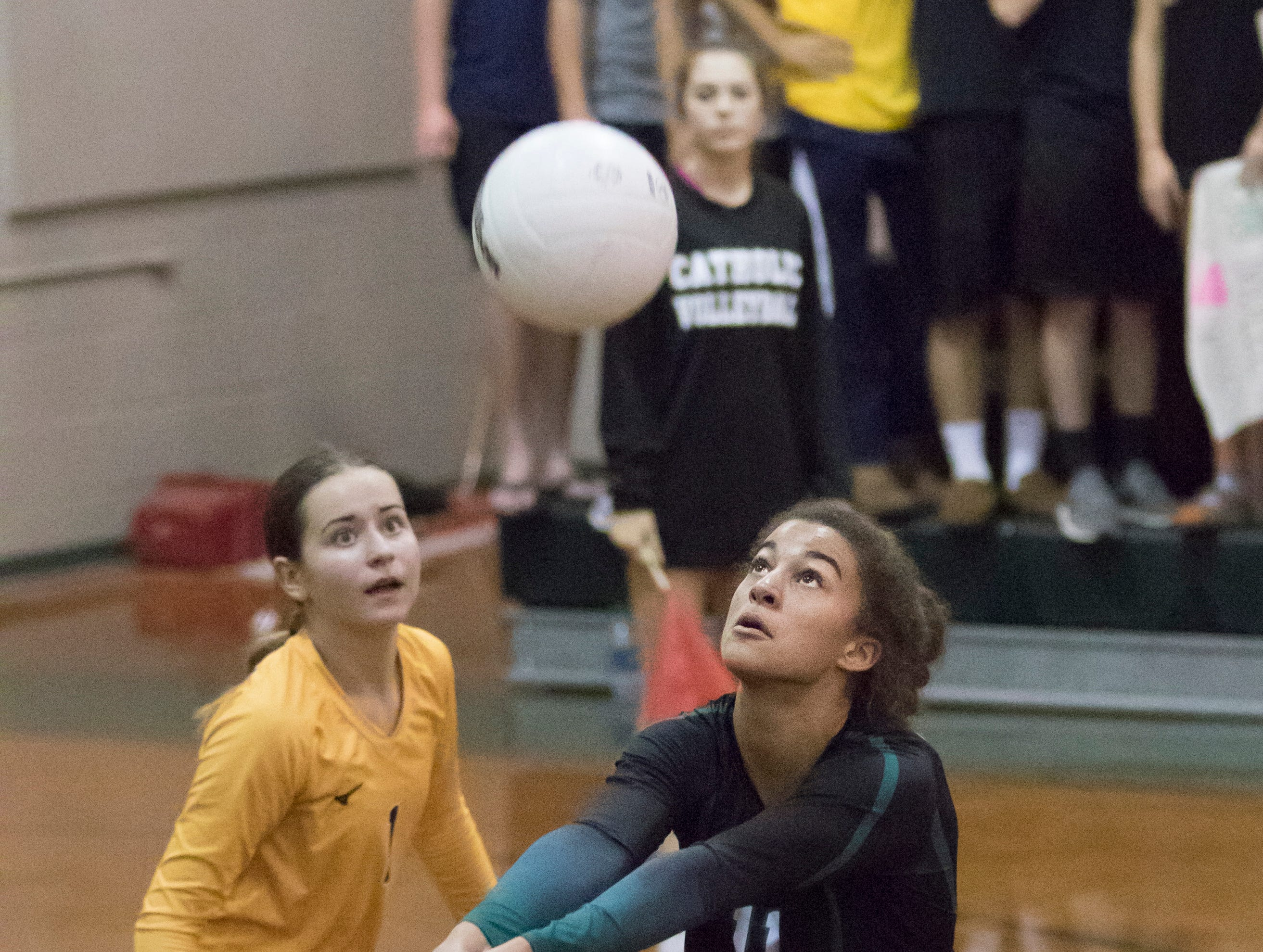 Crusader freshman Amiah Butler (11) plays the ball during the Gulf Breeze vs Catholic volleyball match at Pensacola Catholic High School on Thursday, October 11, 2018.