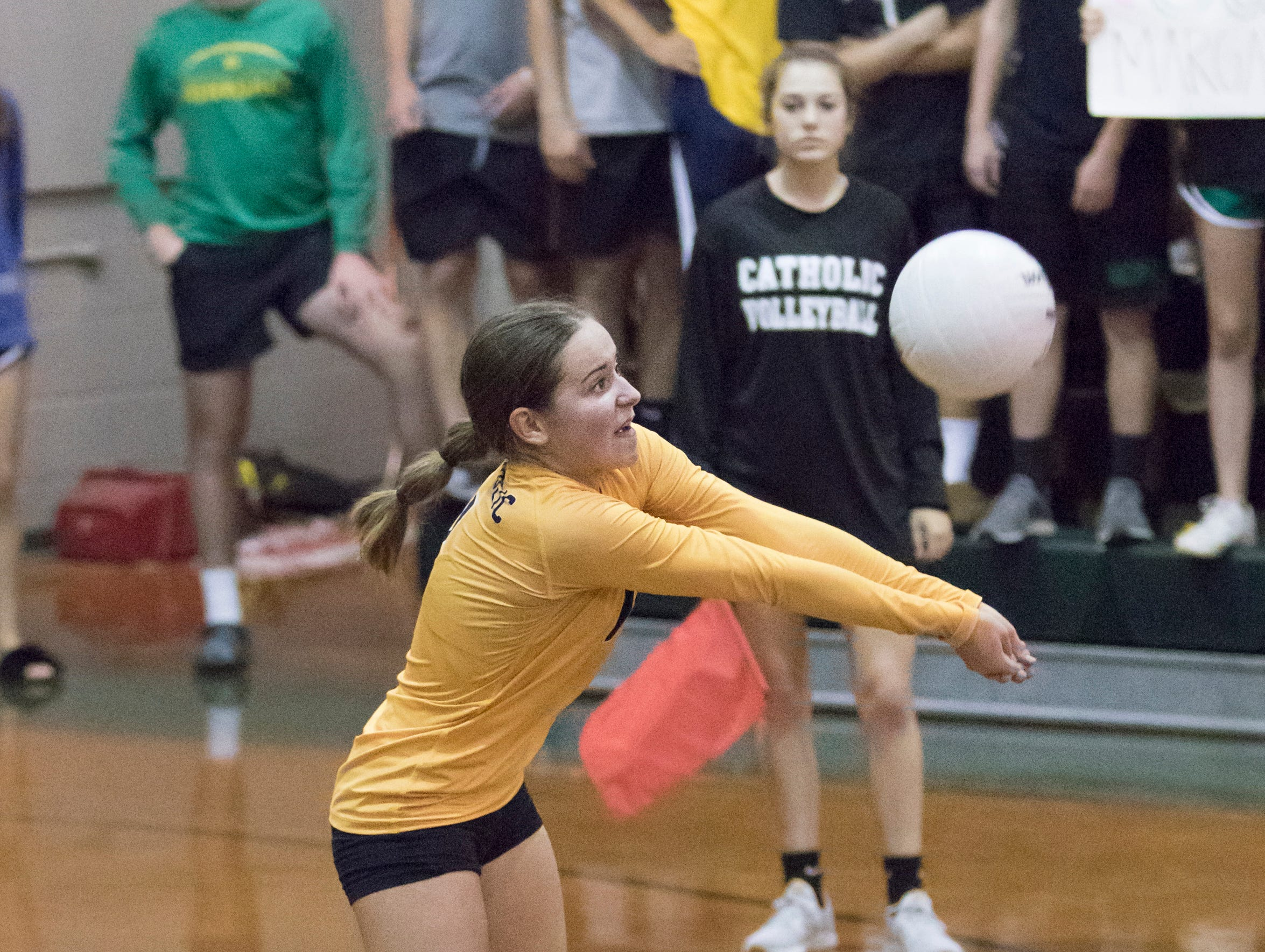 Madison Galloway (1) hits the ball during the Gulf Breeze vs Catholic volleyball match at Pensacola Catholic High School on Thursday, October 11, 2018.