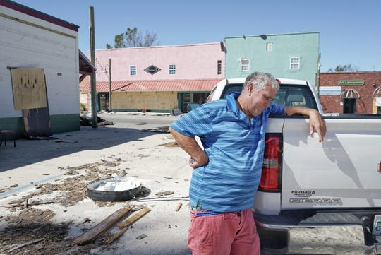 Mitch Holman and one of his sons initially tried riding out Hurricane Michael on his boat but were forced to run the boat aground. He and his son crawled to seek shelter inside Gulf Coast State College.