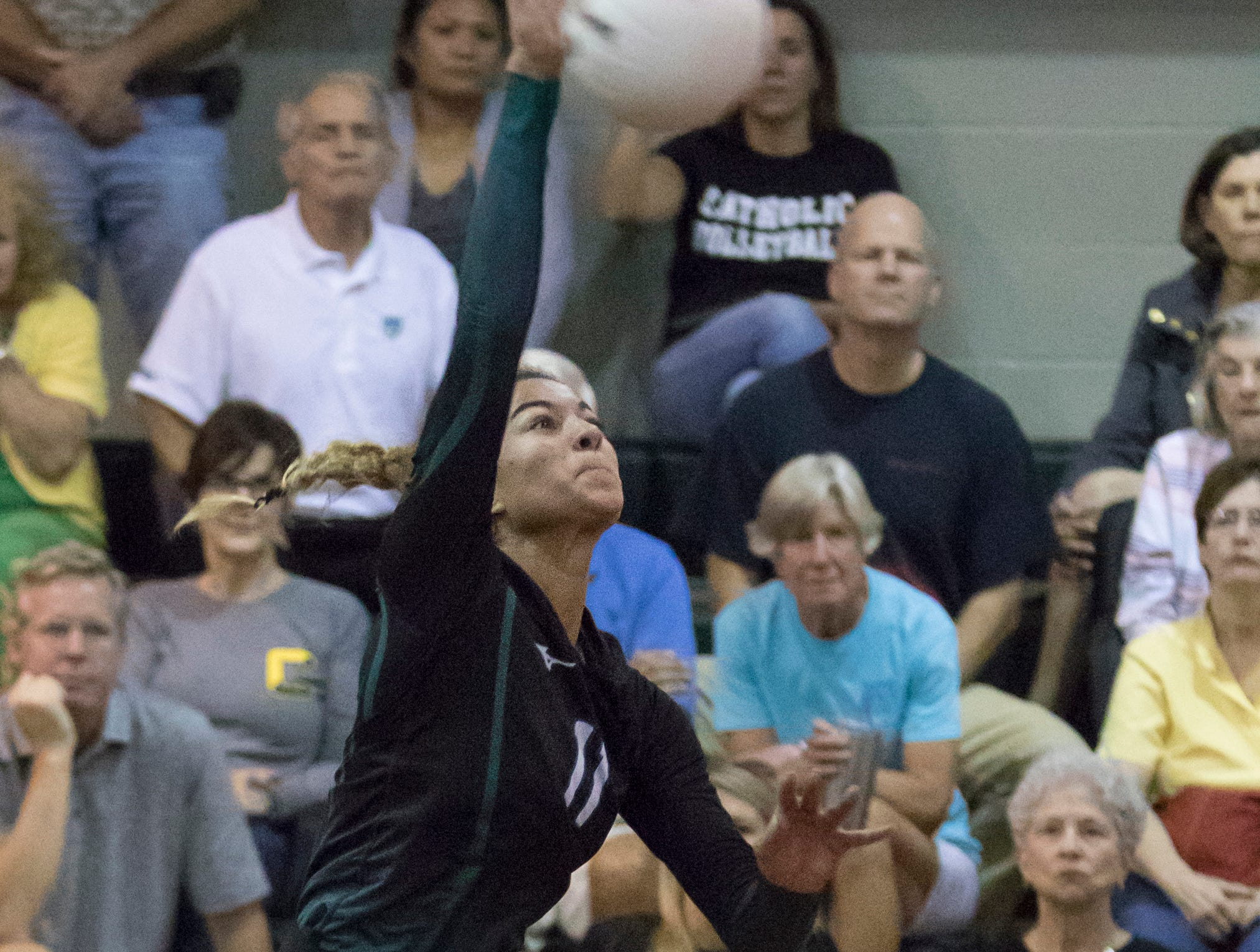 Crusader freshman Amiah Butler (11) leaps for a ball during the Gulf Breeze vs Catholic volleyball match at Pensacola Catholic High School on Thursday, October 11, 2018.