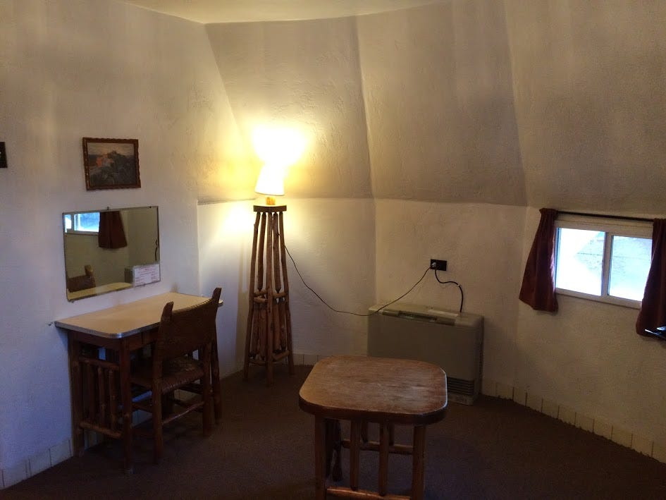 The sloping walls add character to a room at the Wigwam Motel.