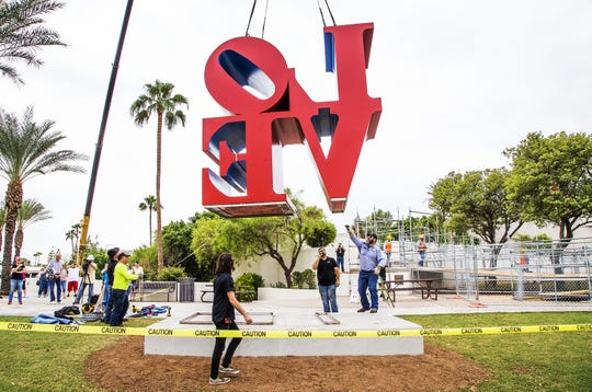 "A giant crane moves the ""LOVE"" sculpture to its new location in front of the Scottsdale Center for the Art on Oct. 12, 2018.  The new spot is about 130 feet east of the original location."