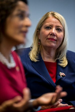 Rep. Debbie Lesko listens to Dr. Hiral Tipirneni speak during an editorial board meeting on Thursday, Oct. 11, 2018, at The Arizona Republic in Phoenix.