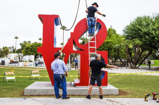 "The ""LOVE"" sculpture is secured in its new location about 130 feet east of its original location in front of the Scottsdale Center for the Arts on Oct. 12, 2018."