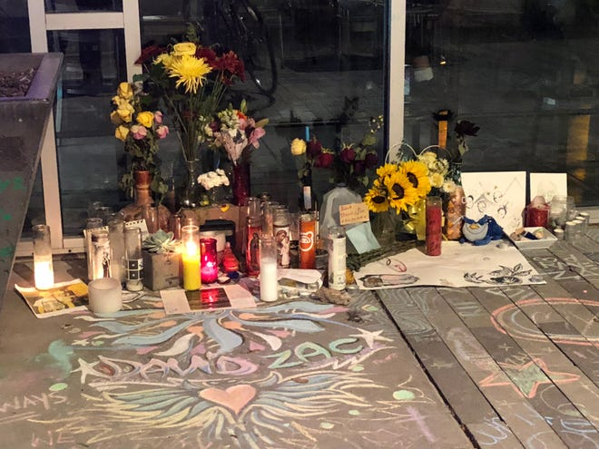 A memorial for David Bessent and Zachary Walter, both cooks at Jobot, grows after the two died from a shooting on Oct. 5, 2018.
