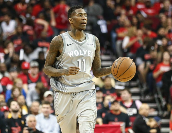 Minnesota Timberwolves guard Jamal Crawford (11) dribbles the ball in game one of the first round of the 2018 NBA Playoffs against the Houston Rockets at Toyota Center.