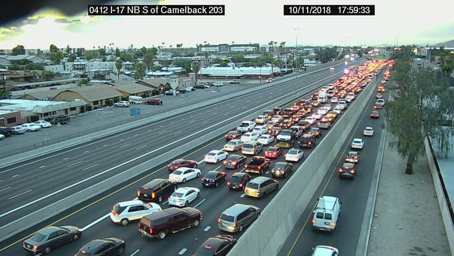 An Arizona Department of Transportation freeway camera shows traffic at a standstill on the northbound side of Interstate 17 in Phoenix on Thursday for a police situation.
