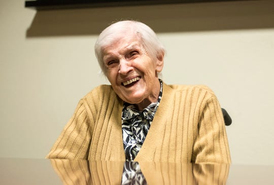 Anna Goloda, 104, laughs at a joke during an interview Friday, Oct. 12, 2018 at Sanctuary at Mercy Village.