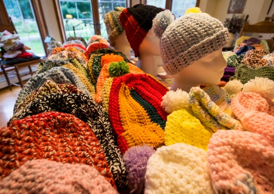 Margie Starkey makes hats, gloves and scarves each year to give to local charities.