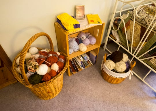 Balls of yarn sit in baskets throughout Margie Starkey's Fort Gratiot home. Starkey makes hats, gloves and scarves each year to give to local charities.