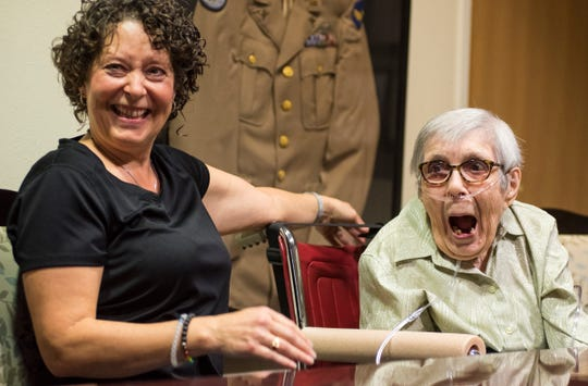 Ann Tompert,100, right, laughs at a joke with her caregiver Angela Ward  during an interview Friday, Oct. 12, 2018 at Sanctuary at Mercy Village.