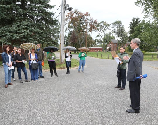 At right, Fishkill Town Supervisor Bob LaColla speaks to a group of developers before they tour the Beacon Correctional Facility on October 11, 2018. New York State is accepting RFPs on the property, and to entice bidders has been giving tours of the property.