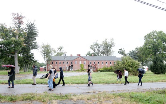 A group of potential developers walk the grounds during a tour at the Beacon Correctional Facility on October 11, 2018.