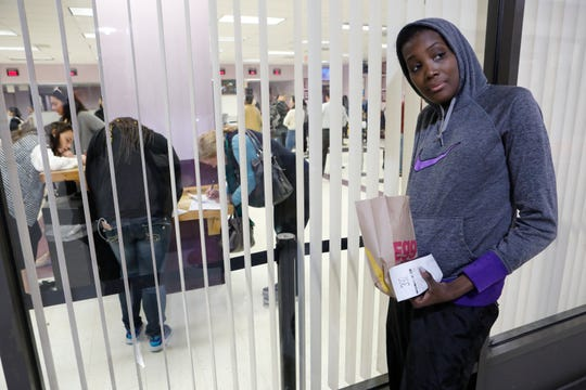 Akimie Worrell of Mount Vernon waits for her mother to get out of the White Plains Department of Motor Vehicles on Oct. 12, 2018.  She has been waiting for over 2 hours.