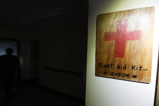 A sign indicating the location of a first aide kit inside a classroom building at the Beacon Correctional Facility on October 11, 2018.
