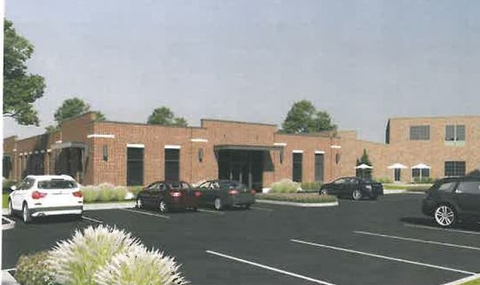 A computer illustration showing what the former Jennings dealership at Grant and Second streets should look like once renovation is completed.