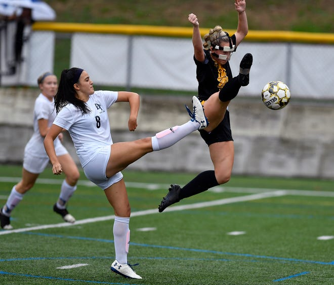 Red Lion's Gabby Young makes a leaping attempt to kick the ball away from Madelyn Rodriguez of Dallastown. Young was named the York-Adams Division I Co-Player of the Year by the coaches. John A. Pavoncello photo