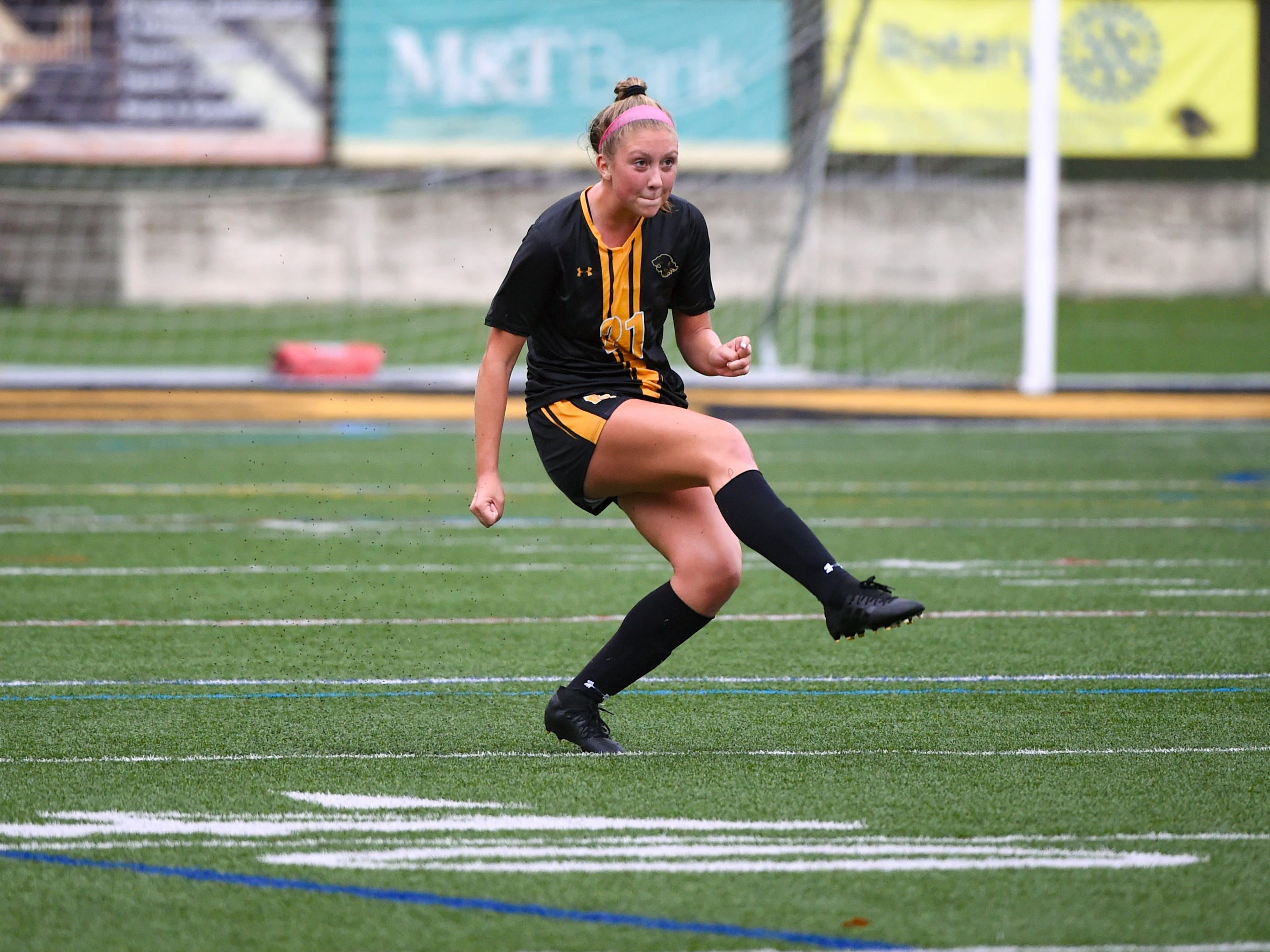 Red Lion's Keirsten Strong (21) takes the free kick during the girls soccer game, October 11, 2018. The Lady Lions beat the Wildcats 4-0.