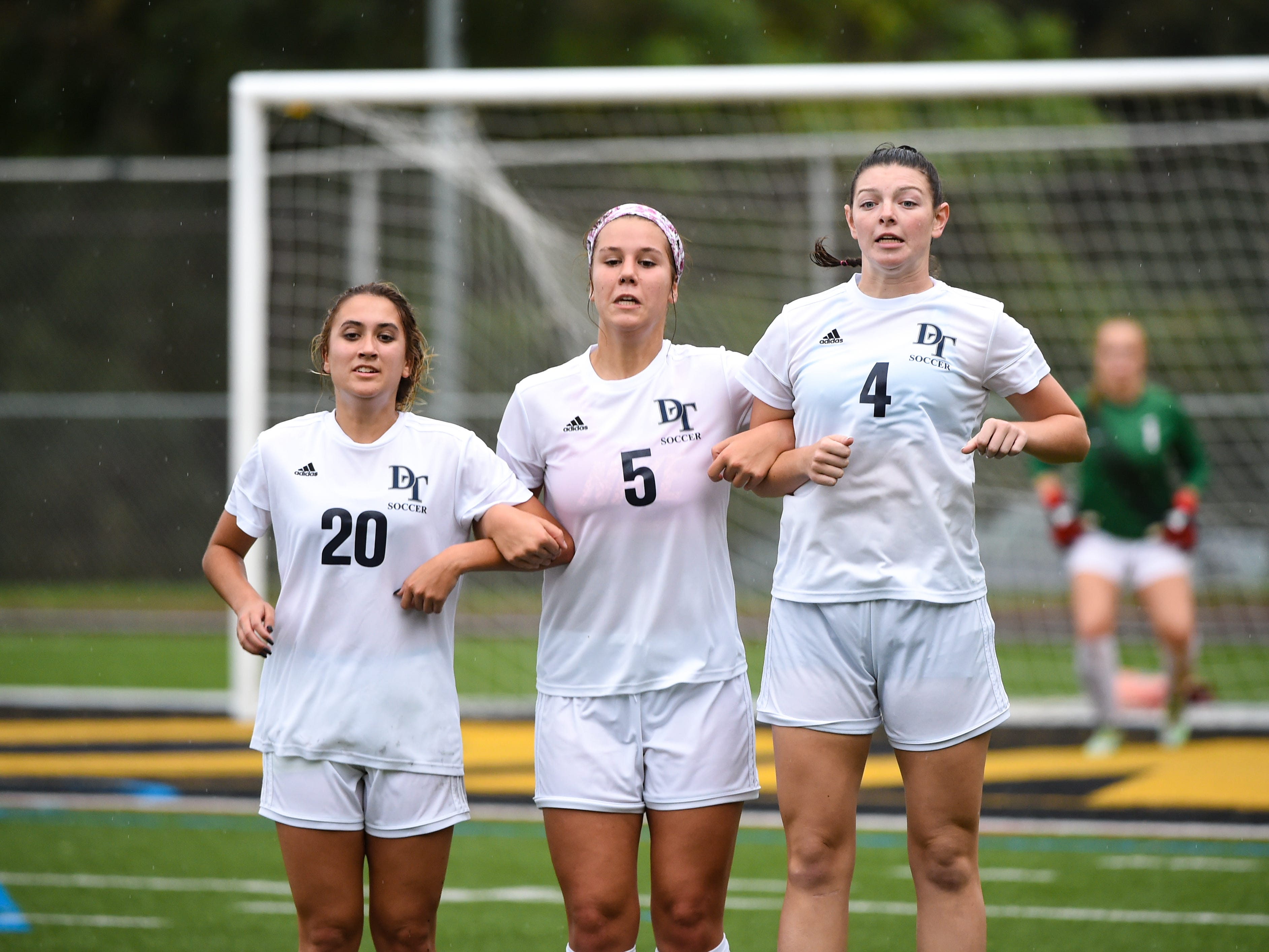 Jordan Lese (20), Emma Schmitt (5) and Skyler Wise (4) set up the wall during the girls soccer game between Red Lion and Dallastown, October 11, 2018. The Lady Lions beat the Wildcats 4-0.